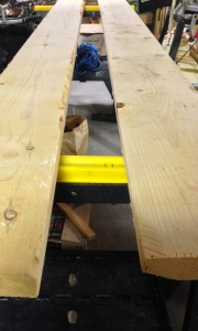 Two or three boards across sawhorses keeps everything elevated.